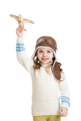 kid girl dressed pilot helmet and playing with wooden airplane t