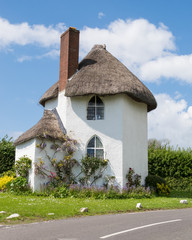 White, Thatched Cottage