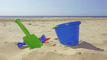 bucket and shovel on the beach