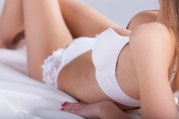Woman lying in white lingerie