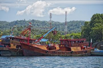 rusty rugged ship in indonesia harbor