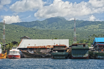 rusty rugged ship in indonesia harbor