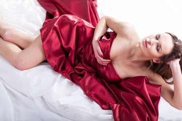 Sensual woman covered with red silk