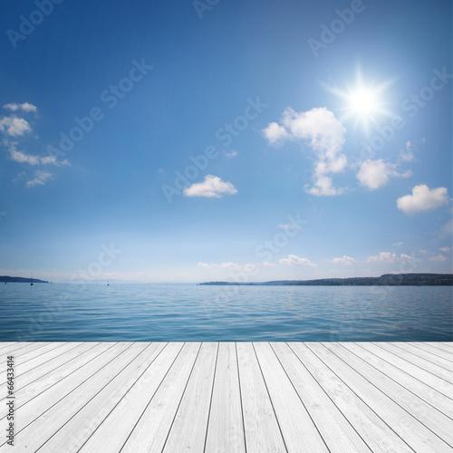 canvas print picture Landschaft mit Holz und See / Meer im Hintergrund