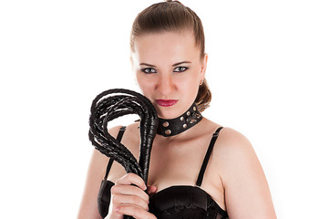 sexy woman in the role of  mistress with a whip in hand