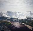 Top view of clouds above lowland of the great river
