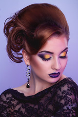 Stylish woman with creative hairstyle and make up in studio