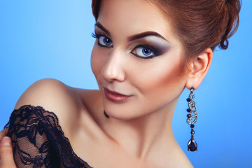 Glamour young adult person with make up on blue background