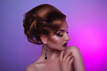 Creative hairstyle and professional make up on fashion woman