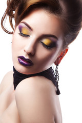 Portrait of gorgeous woman with closed eyes and make up in studi
