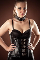 beautiful woman in corset and spiked collar