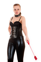 sexy woman in the image of mistress gives the command