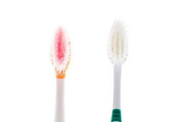 Two Color worn toothbrush on isolated white background