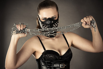 woman in a mask with a chain in hands