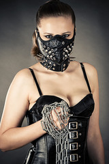 beautiful woman in a mask with a chain in hand