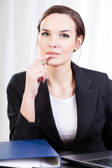 Businesswoman in an office contemplateing