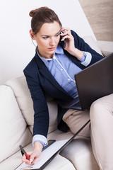 Multitasking woman working at home