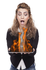 young woman with tablet on fire