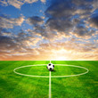 Soccer ball on football playground