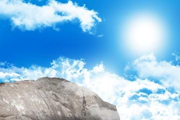 Large rock overlooking blue sky