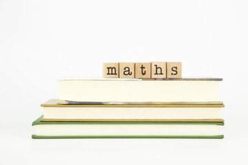 maths word on wood stamps and books