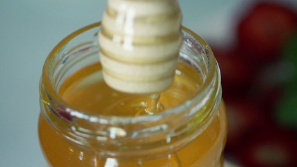 Closeup shot of honey in jar, super slow motion