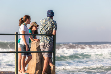 Teenager Girls  Boy Watching Ocean Waves Power