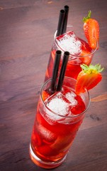 two glasses of strawberry cocktail with ice