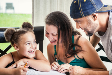 Dad, Mom and daughter homework - stock image