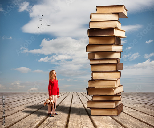 canvas print picture The little girl and books
