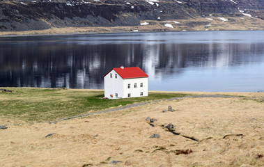 Sea and mountain landscape with traditional icelandic house