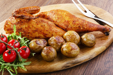 half baked chicken with new potatoes