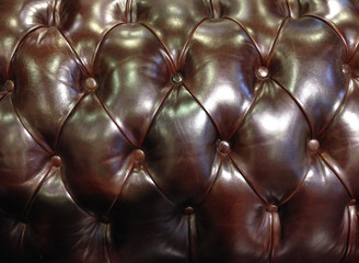 Leather background of brown sofa