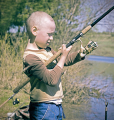The boy spinning reel fishing rods