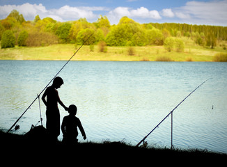 Silhouettes of children on fishing