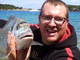 Pescatore con orata