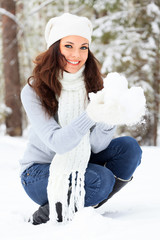 Smiling woman in a winter forest