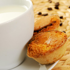 milk and pasteis de feijao, typical Portuguese pastries