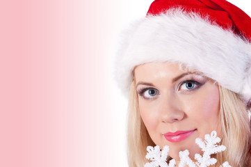 Portrait of woman in Santa's hat