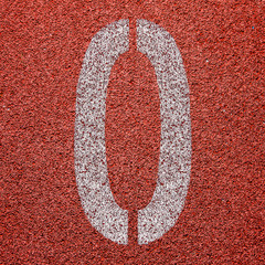 """0"" Numbers on red running track"