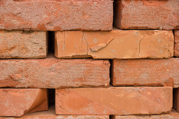 Stacked orange solid clay brick background
