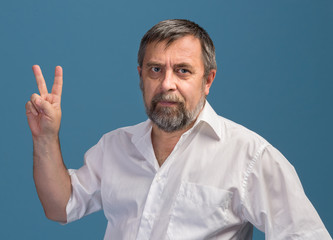 Man in  showing victory sign