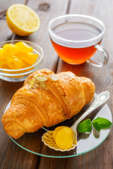 cup of tea, croissant, lemon and mint