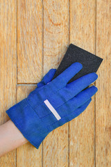 Plank wood preparation with sanding sponge block for varnishing