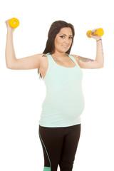 woman pregnant fitness flex yellow weights tattoo