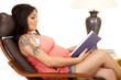 woman tattoo pink shirt sit read side