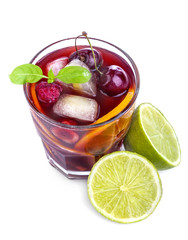 Sangria with citrus and other fruit on a white background