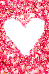 pink rose petals in shape of heart with space for text