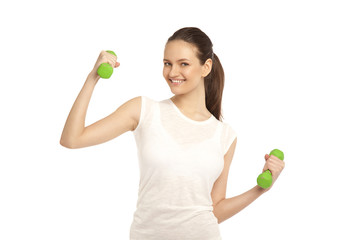 Young girl with dumbbells on a white background. Green