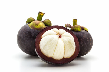 Mangosteen,cross section showing the thick purple skin.